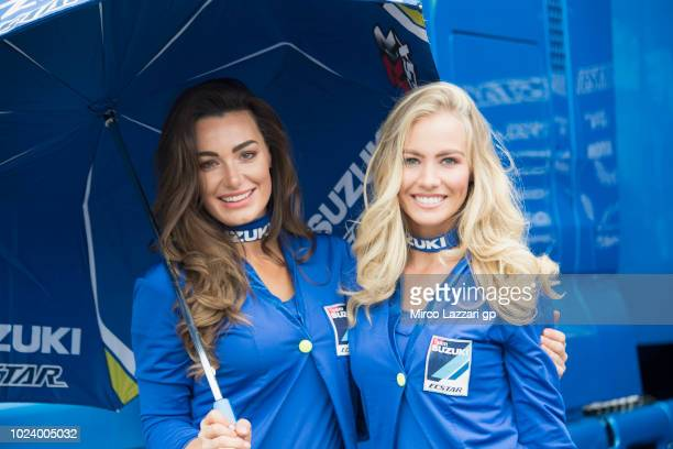 The Grid girls pose in paddock during the MotoGp Of Great Britain Race at Silverstone Circuit on August 26 2018 in Northampton England
