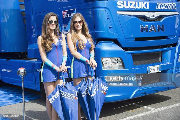 The grid girls pose in paddock during the qualifying practice during MotoGp Of Great Britain Qualifying at Silverstone Circuit on August 29 2015 in...