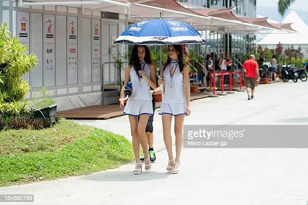 The grid girls walk in paddock during the free practice of the MotoGP Of Malaysia at Sepang Circuit on October 19 2012 in Kuala Lumpur Malaysia