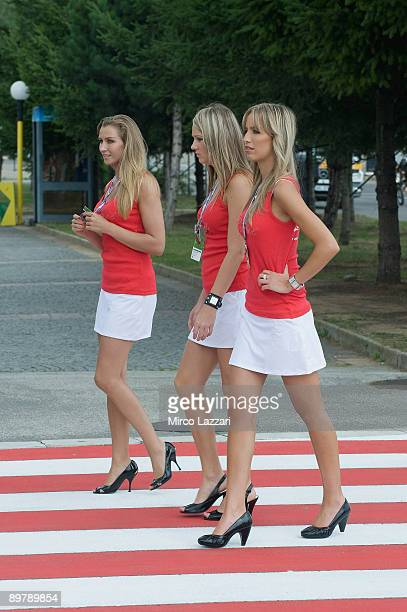 The grid girls walk in paddock during the free practice of the MotoGP World Championship Grand Prix of Czech Republic on August 14 2009 in Brno Czech...