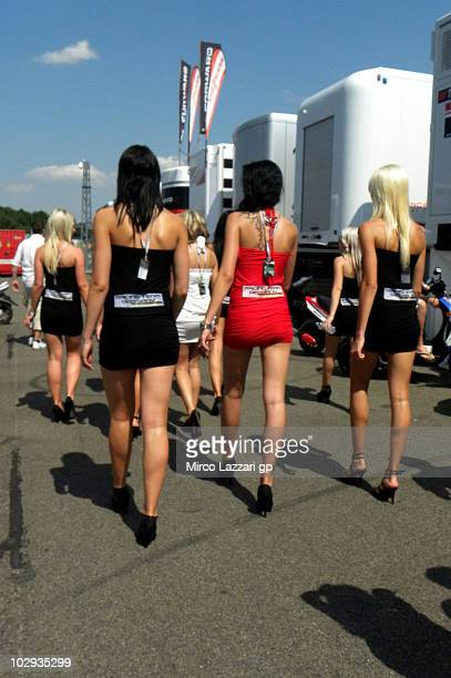 The grid girls walk in paddock during the pit walk during the Grand Prix of Germany at Sachsenring Circuit on July 16 2010 in HohensteinErnstthal...