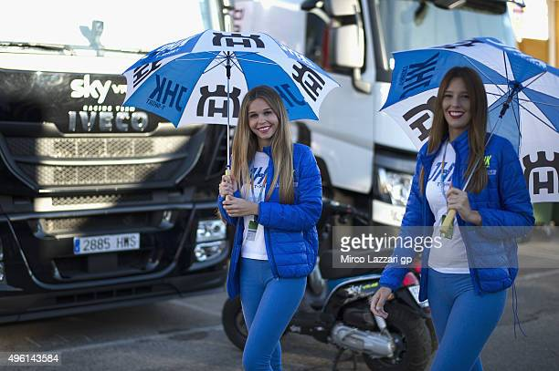 The grid girls walk in paddock during the qualifying practice during the MotoGP of Valencia Qualifying at Ricardo Tormo Circuit on November 7 2015 in...