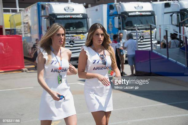 The grid girls walk in paddock during the qualifying practice during the MotoGp of Catalunya Qualifying at Circuit de Catalunya on June 16 2018 in...