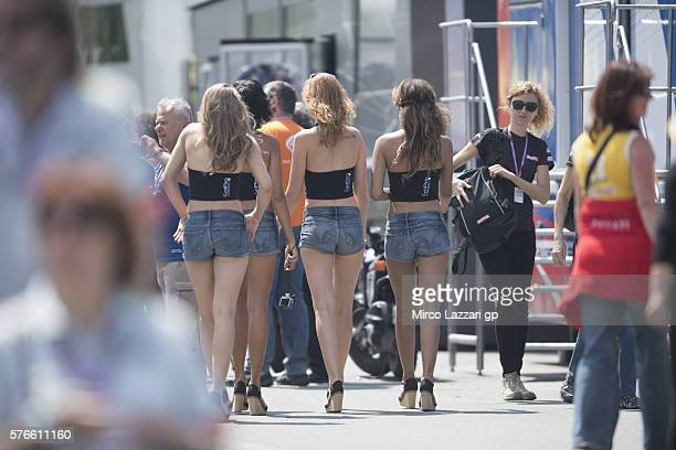 The grid girls walk in the paddock during the MotoGp of Germany Qualifying at Sachsenring Circuit on July 16 2016 in HohensteinErnstthal Germany