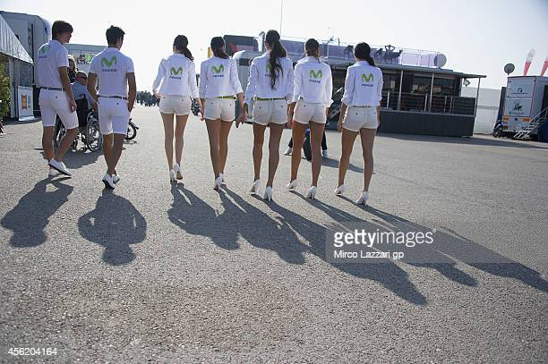 The grid girls walk in the paddock during the MotoGP of Spain Qualifying Practice at Motorland Aragon Circuit on September 27 2014 in Alcaniz Spain