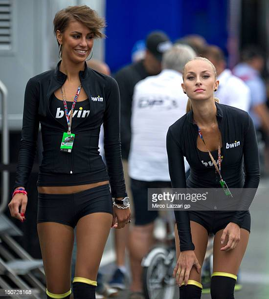 The grid girls walk in the paddock during the qualifying practice of the MotoGp of Czech Republic at Brno Circuit on August 25 2012 in Brno Czech...