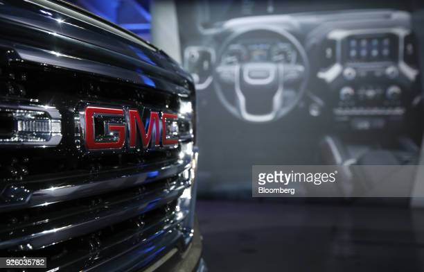 The grille of a General Motors Co 2019 GMC Sierra SLT truck is seen during an event at Russell Industrial Complex in Detroit Michigan US on Thursday...