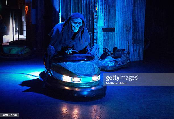 The Grim Reaper rides a dodgem car at Banksy's Dismaland on September 10 2015 in WestonSuperMare England