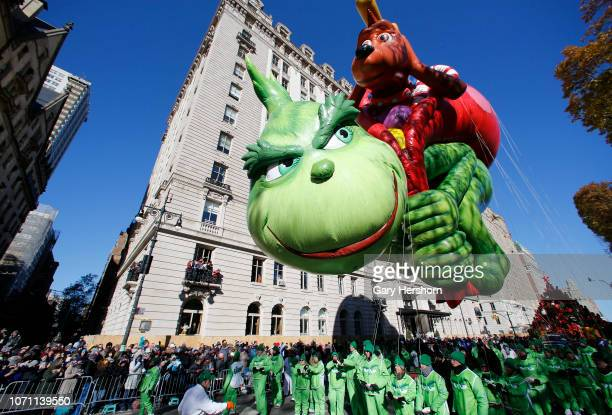 The Grinch balloon floats down Central Park West during the 92nd Annual Macy's Thanksgiving Day Parade on November 22 2018 in New York City