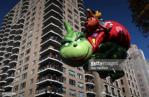 The Grinch balloon floats down Central Park West during the annual Thanksgiving Day Parade on November 23 2017 in New York City The Macy's...