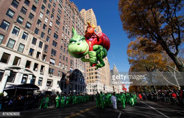 The Grinch balloon floats down Central Park West during the annual Thanksgiving Day Parade on November 23 2017 in New York City