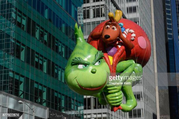 The Grinch balloon floats on 6th Ave during the annual Macy's Thanksgiving Day parade on November 23 2017 in New York City The Macy's Thanksgiving...