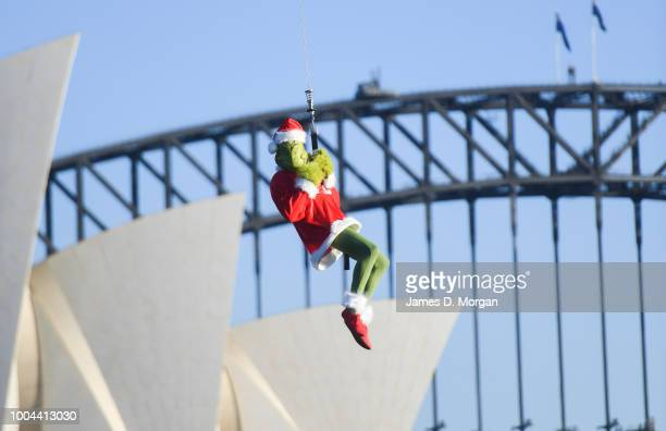 The Grinch hangs outside a helicopter above the Harbour Bridge and Opera House on July 24 2018 in Sydney Australia As Australians celebrate Christmas...