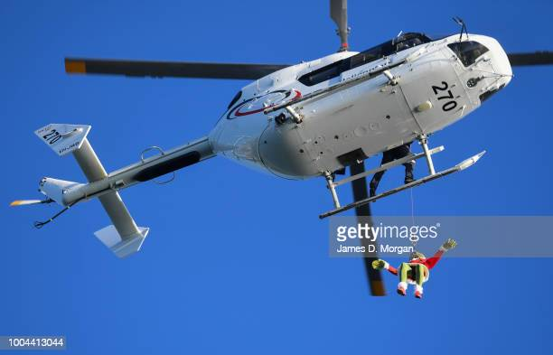 The Grinch hangs outside a helicopter above the harbour on July 24 2018 in Sydney Australia As Australians celebrate Christmas in July Carnival...