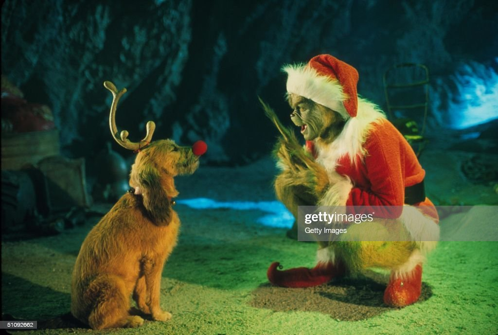 The Grinch Played By Jim Carrey Conspires With His Dog Max To Deprive The Who's Of Thei : News Photo