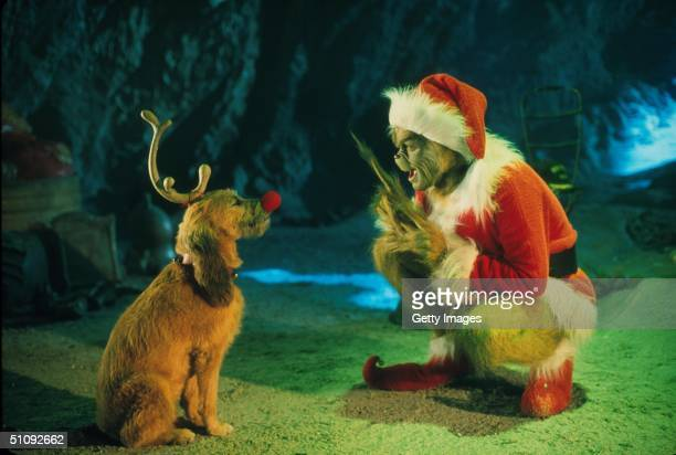 The Grinch Played By Jim Carrey Conspires With His Dog Max To Deprive The Who's Of Their Favorite Holiday In The LiveAction Adaptation Of The Famous...