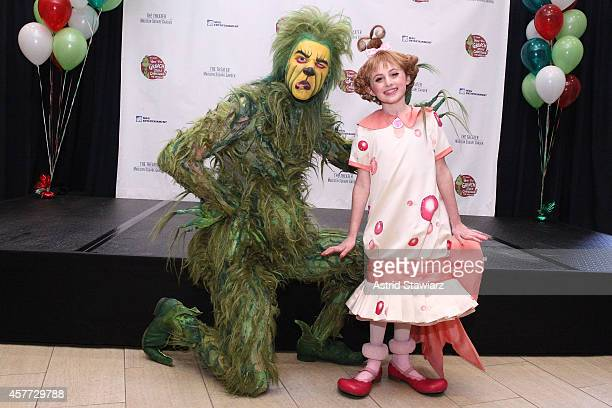The Grinch poses with Presley Ryan during the 2014 Who Lookalike Contest at Madison Square Garden on October 23 2014 in New York City