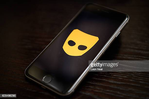 The 'Grindr' app logo is seen on a mobile phone screen on November 24 2016 in London England Following a number of deaths linked to the use of...