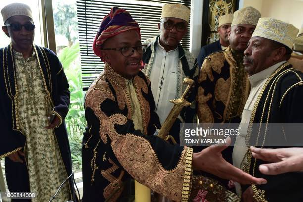 The groom is received at the bride's home during a traditional wedding ceremony in Moroni July 28 capital of the volcanic Comoros archipelago off...