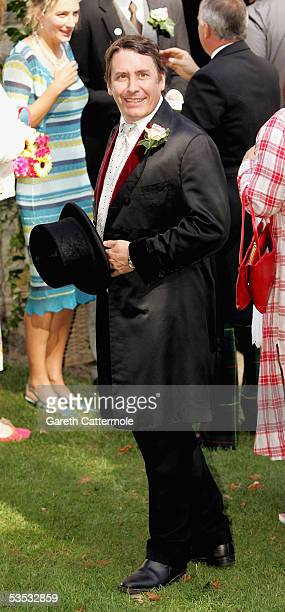 The groom Jools Holland looks on at his wedding to Christabel McEwen at St James's Church Cooling on August 30 2005 in Cooling England The Archbishop...
