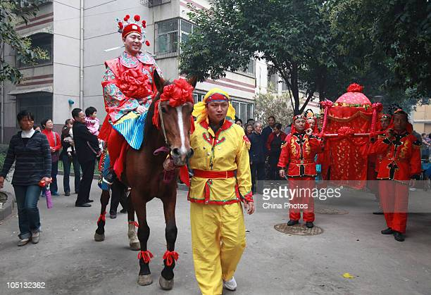 The groom sits on a horse while the bride sits in a sedan chair during an ancient style wedding ceremony on October 10 2010 in Xian of Shaanxi...