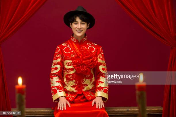 the groom wore ancient costume - uvula stock photos and pictures