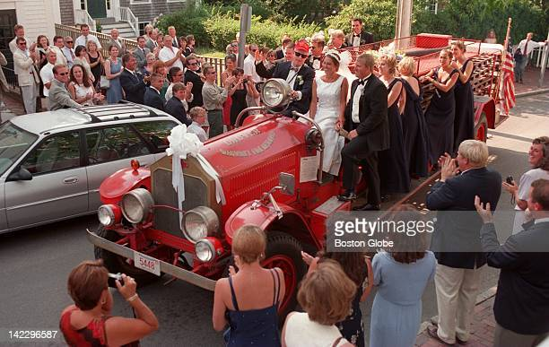 The groom's father H Flint Ranney drives a 1927 American LaFrance fire truck leading the wedding party of son Jamie Ranney and his wife Alisha...