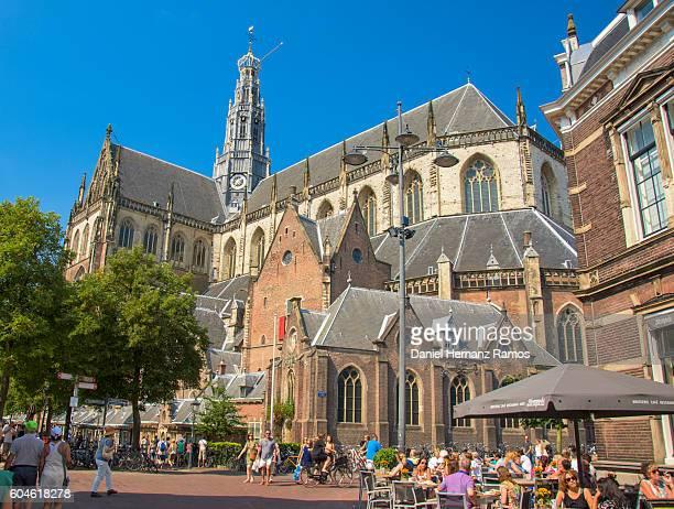 The Grote Kerk or St. Bavokerk in the city of Haarlem agains blue sky. The Netherlands