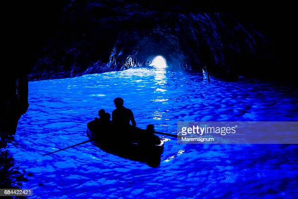 the grotta azzurra (blue grotto), a boat - capri stock pictures, royalty-free photos & images