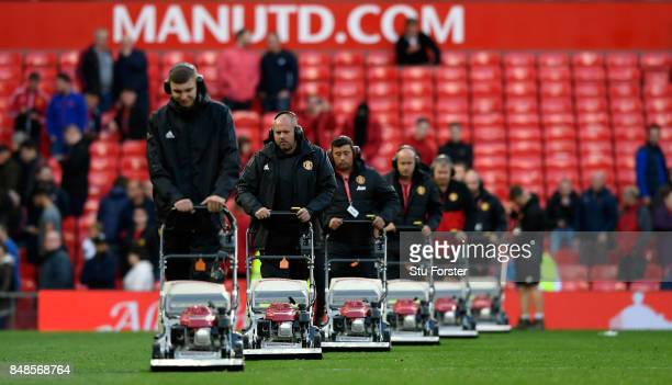 The ground staff cut the grass with their fleet of lawnmowers after the Premier League match between Manchester United and Everton at Old Trafford on...