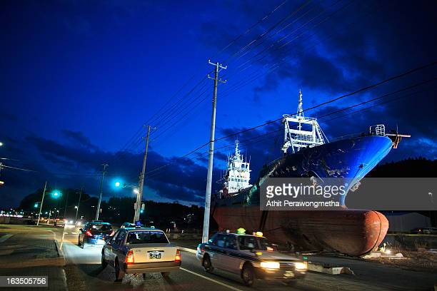 The grounded No18 Kyotoku Maru fishing boat is illuminated as Japan commemorates the victims of the 2011 Magnitude 90 earthquake and subsequent...