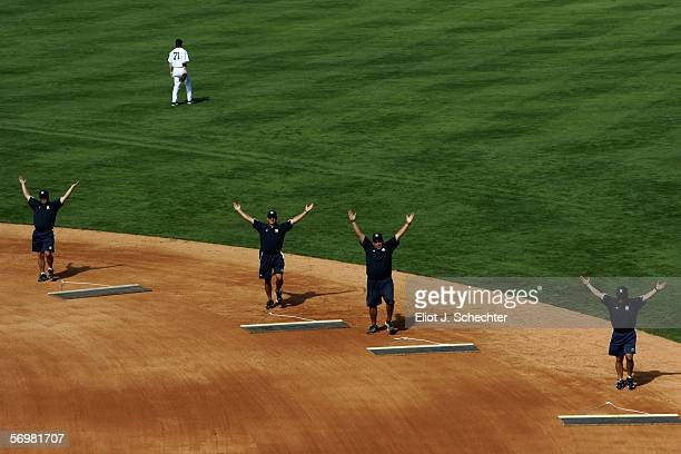 The grounds crew do their rendition of YMCA during the 7th inning stretch while the New York Yankees play the Philadelphia Phillies during a spring...