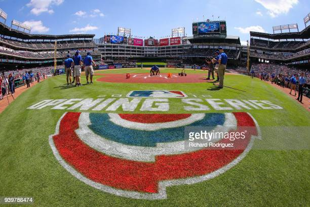 The grounds crew prepare the field for the Opening Day baseball game between the Houston Astros and Texas Rangers at Globe Life Park in Arlington on...