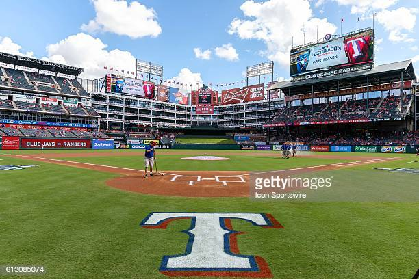 The grounds crew prepares the field prior to game 1 of the ALDS between the Toronto Blue Jays and Texas Rangers at Globe Life Park in Arlington TX