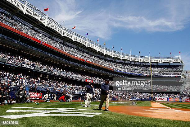The grounds crew put on some finishing touches to the field prior to the New York Yankees playing the Cleveland Indians on opening day on April 16...