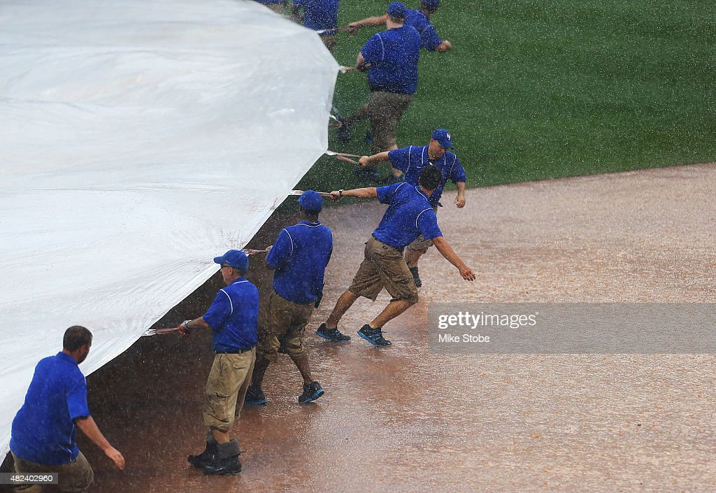 The grounds crew put the tarp on the field for a rain delay in the ninth inning during the game against the San Diego Padres at Citi Field on July 30, 2015 in Flushing neighborhood of the Queens borough of New York City.