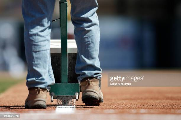 The grounds crew stripes the field before the Spring Training game between the Toronto Blue Jays the Detroit Tigers at Joker Marchant Stadium on...