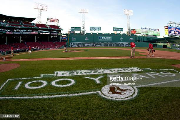 The grounds crew works on the field after the game between the Boston Red Sox and the New York Yankees on Friday April 20 2012 at Fenway Park in...