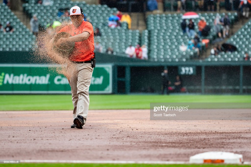 The grounds crew works the field during the seventh inning of the game between the Baltimore Orioles and the Philadelphia Phillies at Oriole Park at Camden Yards on May 16, 2018 in Baltimore, Maryland.