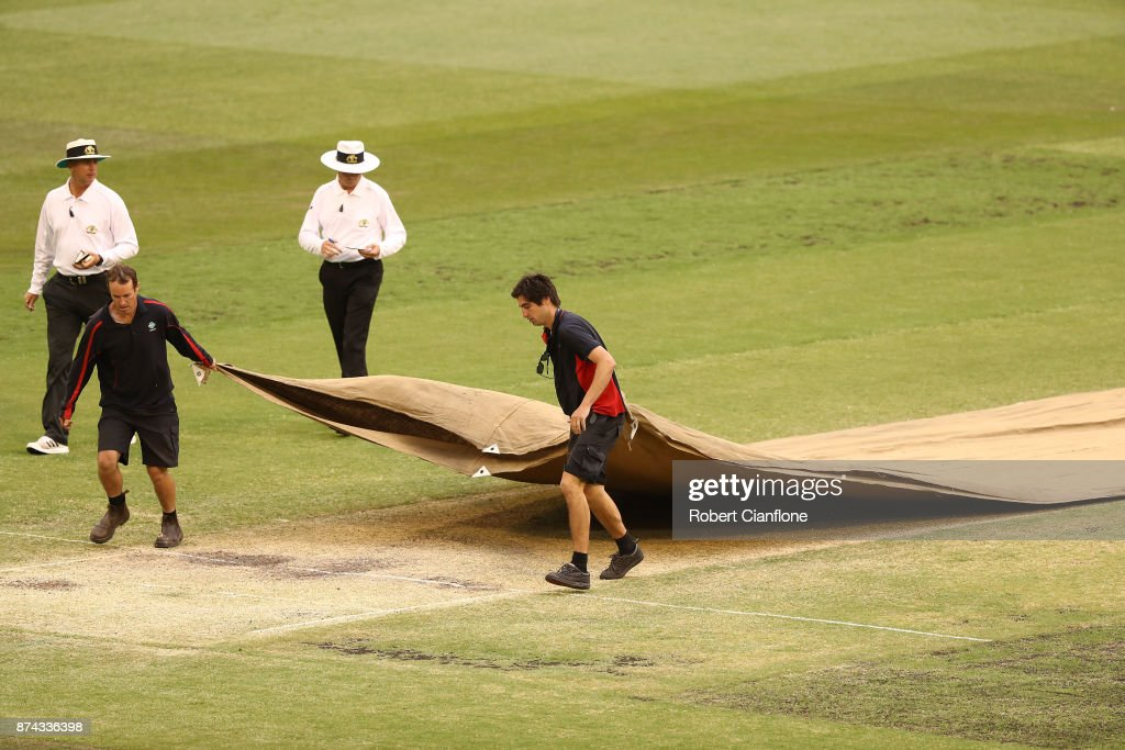 The grounds men cover the pitch as rain stops play during day three of the Sheffield Shield match between Victoria and Tasmania at Melbourne Cricket Ground on November 15, 2017 in Melbourne, Australia.