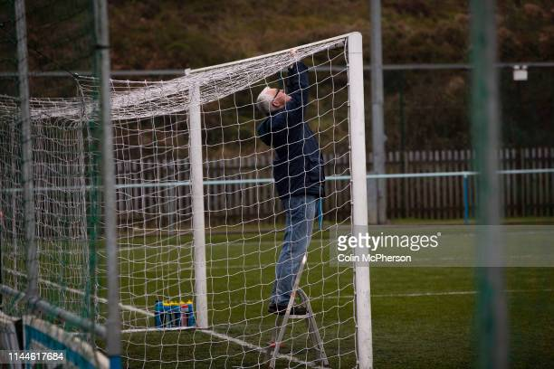 The groundsman inspecting the goal nets before Cambrian and Clydach Vale take on Cwmbran Celtic at King George's New Field in a Welsh League Division...