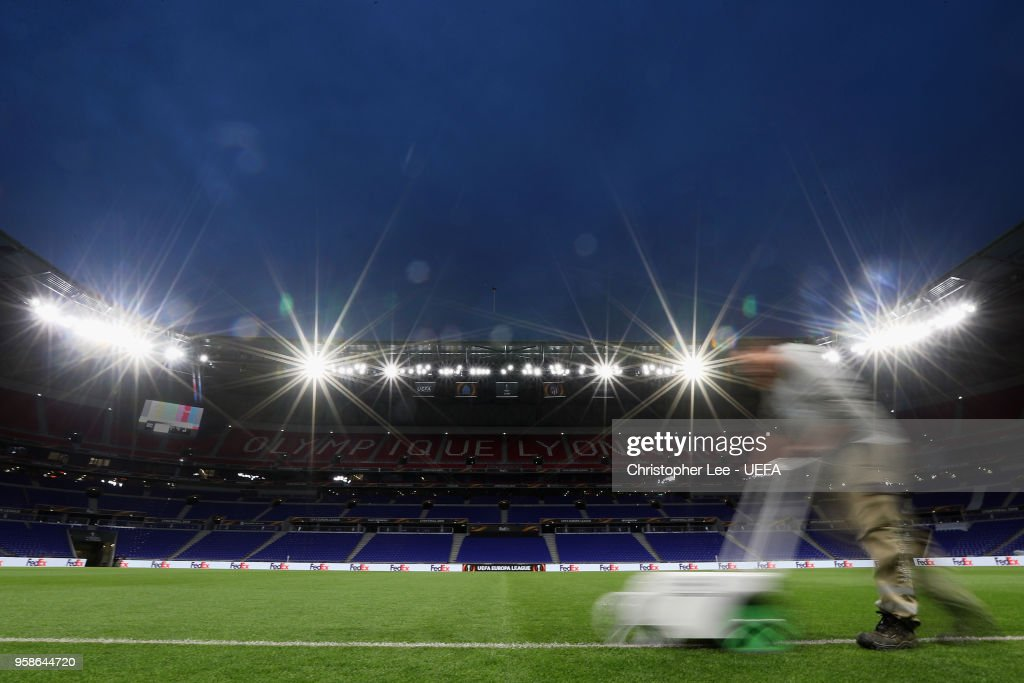 The groundsman paints the white lines in the evening during the UEFA Europa League Final between Olympique de Marseille and Club Atletico de Madrid at Stade de Lyon on May 15, 2018 in Lyon, France.