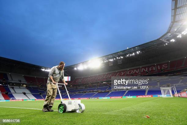 The groundsman paints the white lines in the evening during the UEFA Europa League Final between Olympique de Marseille and Club Atletico de Madrid...