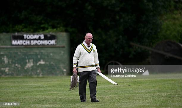 The groundsman preapres the pich between innings during a game of village cricket at Bradfield Cricket Club on May 18 2008 in Bradfield England
