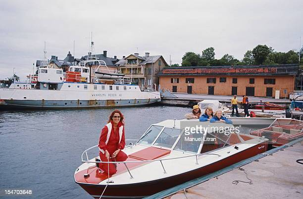 The group ABBA on a boat anchored in a port smiling attitude of AnniFrid Lyngstad in the front rope in hand standing in the back and her husband...