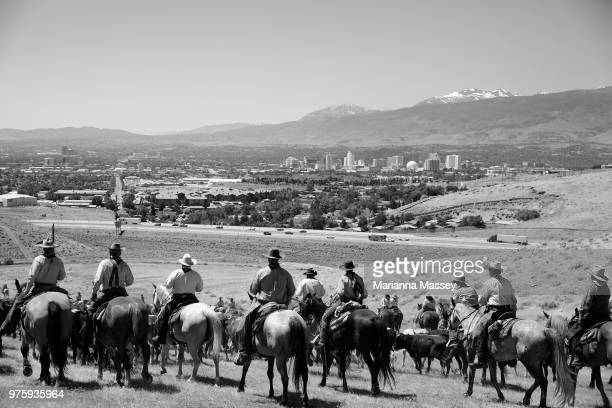 The group crests the hill overlooking the Reno skyline as they make their way back toward Reno on the final day of the drive on June 14 2018 in Reno...