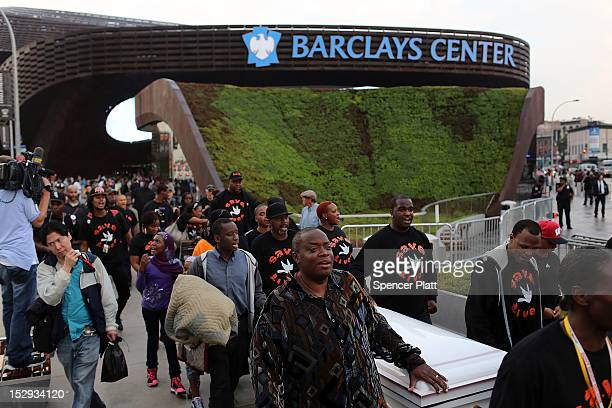 The group Don't Shoot NYC protests against youth violence at the Barclays Center on opening night which was to feature recording artist JayZ on...