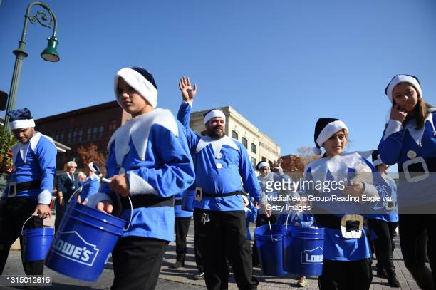 The group from Lowe's hands out chips while going through the square during the 2016 Reading Holiday Parade Saturday. Photo by Lauren A. Little 2016...