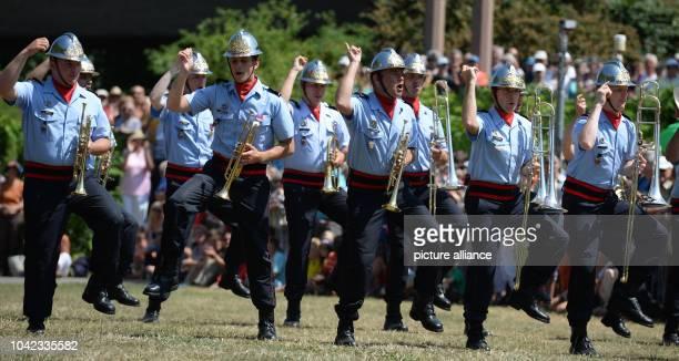 The group 'Musique de la Brigade de SapeursPompiers' from Paris plays and dances in Freiburg Germany 25 July 2013 The Basel Military Music Festival...
