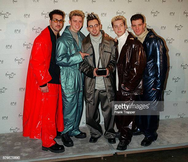 The group N'Sync with the award for best new pop/ rock artist
